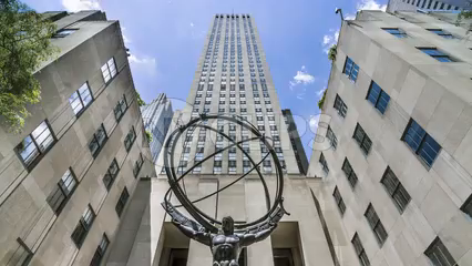 slow tilt to Atlas statue from Rockefeller Center building in Midtown Manhattan - time-lapse in 1080 HD in NYC