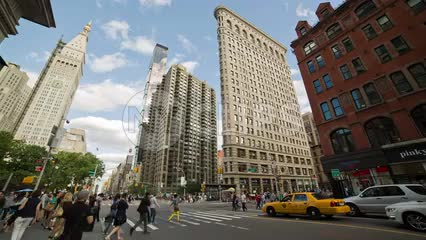 Flatiron Building in Manhattan on summer day - 23rd street - people walking