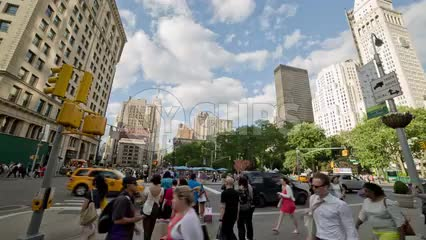 panning view of Madison Square Park and Flatiron Building on 23rd Street and 5th Ave on summer day in Manhattan