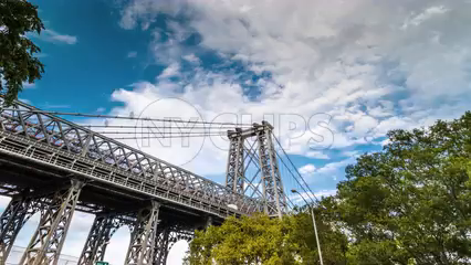 Williamsburg Bridge during the day - 4K timelapse in HDR tilting down to cars driving on highway