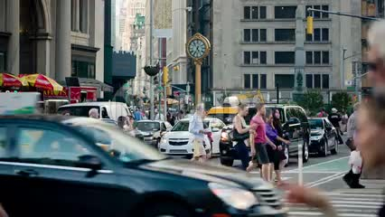 busy intersection on 23rd Street and 5th Ave on summer day in Manhattan