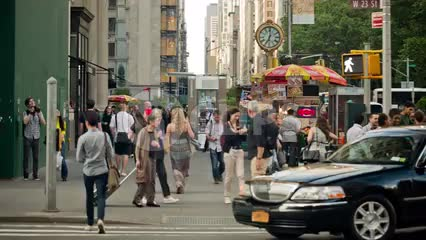 summer day in Manhattan with famous 5th Ave clock - crowded busy street