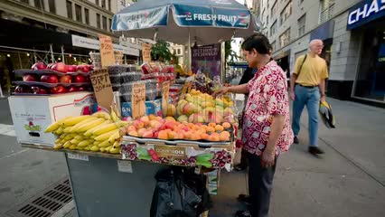 man selling fresh fruit in street - vendor in summer