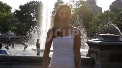 groovy girl jamming with dancing moves in Washington Square Park on sunny bright summer day