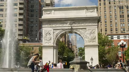pulling back from Washington Square Park fountain and famous arch - 4K timelapse in Manhattan NYC