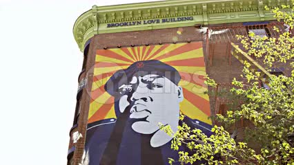Biggie mural on Brooklyn Building above subway station