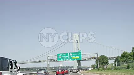 sign for Belt Parkway and BQE, Verrazano Bridge and Staten Island from moving car, driver's POV on highway