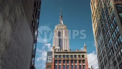 time-lapse zooming in on Empire State Building during day - close-up view from alley between two buildings