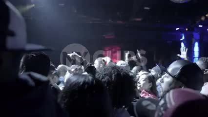 heads bobbing in crowd at hip hop show