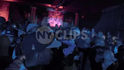 panning by faces in crowd at hip hop show in NYC