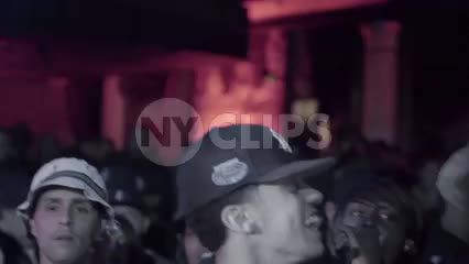 rap fans having fun in audience - man in crowd with Yankee hat enjoying hip hop show