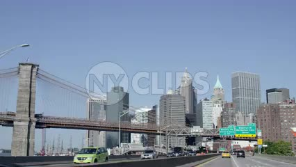 driver pov driving on FDR Drive with Brooklyn Bridge and Lower Manhattan skyline Battery Park sign