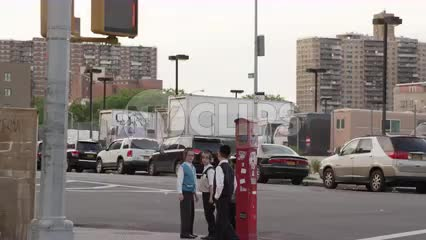 Jewish children playing on street corner in Brooklyn - young Hasidim hanging out on the block