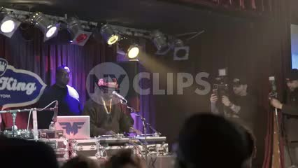 DJ Funkmaster Flex performing at hip hop show - crowd cheering - standing in concert - fans watching music