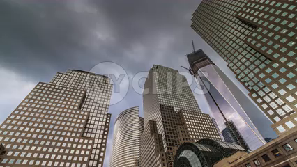 Battery Park with tall buildings overhead - Freedom Tower under construction - timelapse in Manhattan 4K and 1080 HD NYC