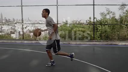 kid dribbling slowly to basket and shooting layup in slow motion - basketball practice in summer