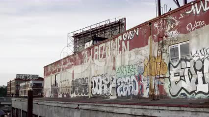 graffiti wall view driving by from highway - gritty vandalism in Brooklyn