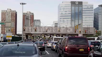 panning across cars in gridlocked traffic - lined up to enter Holland Tunnel