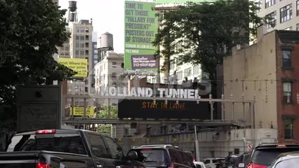 cars lined up in gridlocked traffic entering Holland Tunnel