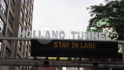 Holland Tunnel and stay in lane sign overhead