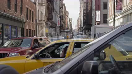 taxi cab stuck in gridlocked traffic on Lower East Side of Manhattan on summer day