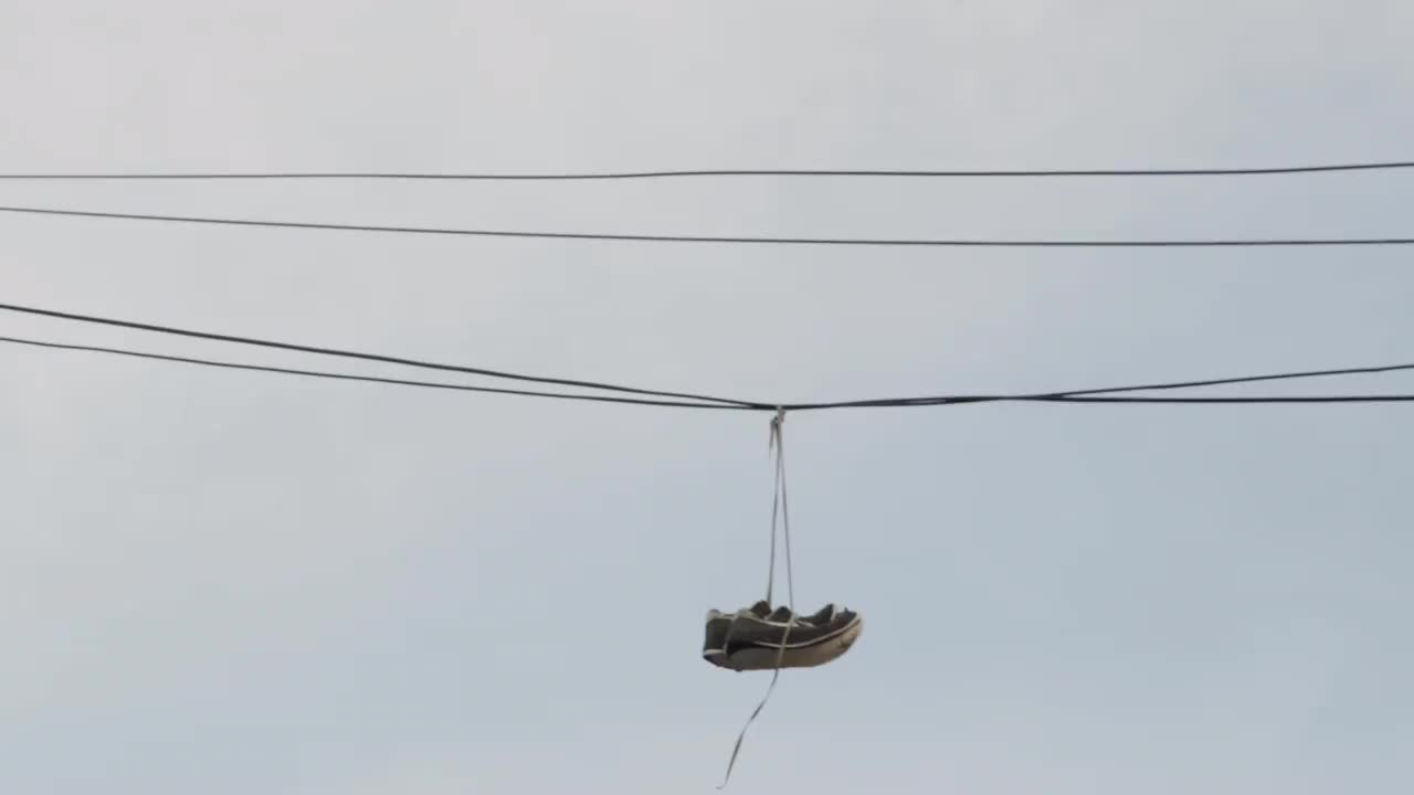 sneakers hanging from power lines - shoe tossing in urban area – NY ...
