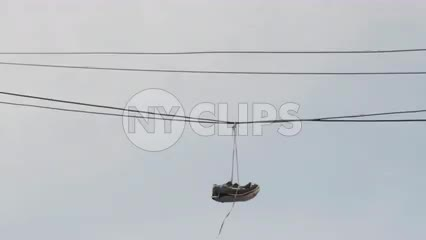 sneakers hanging from power lines - shoe tossing in urban area