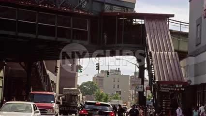 driving under elevated subway station in Brooklyn - slow motion