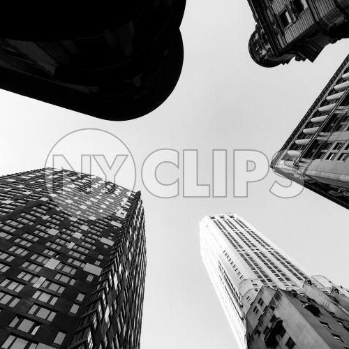 upward angle of tall towering skyscrapers - buildings from street view looking up in Manhattan