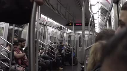 interior subway carriage with people sitting, riding train