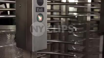 faceless man entering subway station revolving turnstile in slow motion