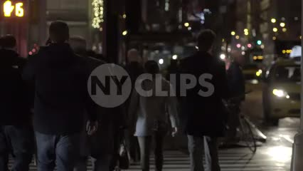 people crossing street late at night in Midtown Manhattan in slow motion