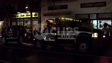NYPD tow truck driving away with parked car - towing at night