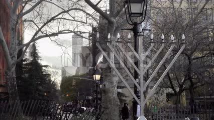 huge Menorah in Washington Square Park on winter day - zooming out with Freedom Tower in background