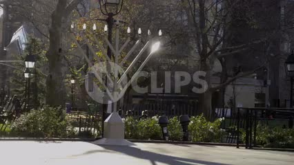 Big Menorah on holidays in Washington Square Park on bright sunny day in NYC