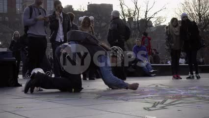 chalk artist in Washington Square Park in late afternoon making beautiful images on ground