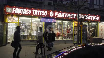 Fantasy Tattoo Party Store at night on 6th Ave in Greenwich Village Manhattan - storefront display
