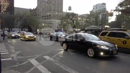 taxicab driving past Union Square on fall day