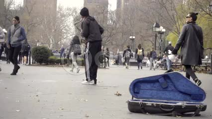 cool saxophone player making music in Washington Square Park for the public