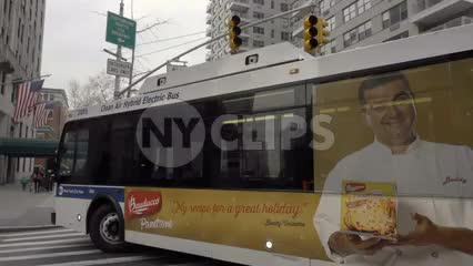MTA public bus turning corner on 5th ave and 8th street in Manhattan NYC