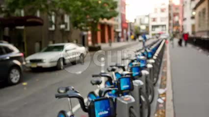 CitiBikes parked at station in long line