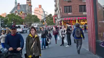 people walking on 6th Avenue - Gray's Papaya on corner of 8th Street - Jefferson Market Library clock tower - Greenwich Village