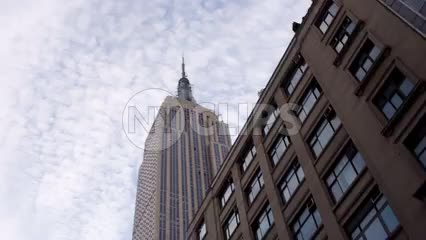 Empire State Building view from driving vehicle - buildings and blue sky