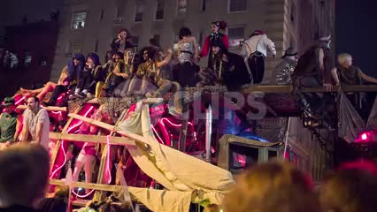 float passing in Halloween parade with people dressed up in costumes in the Village