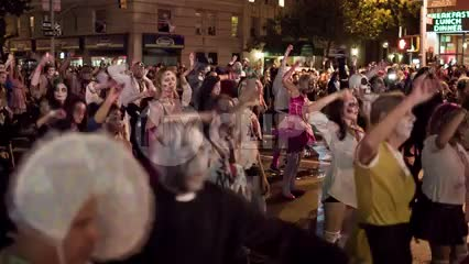 Halloween parade - costumes and monsters doing Michael Jackson Thriller dance - people dancing on 6th Ave and 8th Street in Greenwich Village