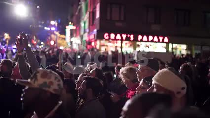 people on 6th ave and 8th street - crowd at Halloween parade with Gray's Papaya
