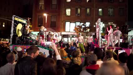 Halloween parade float with crowd on 6th avenue