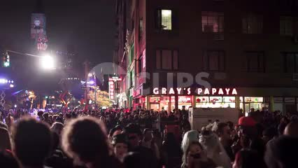 crowd at Halloween parade - Gray's Papaya on 8th st and 6th Ave in Greenwich Village