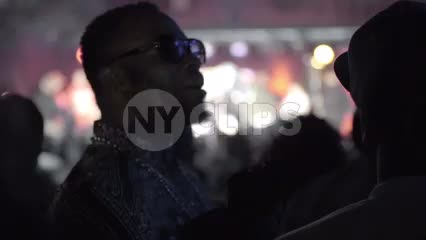 man with sunglasses in crowd at hip hop show - live music concert