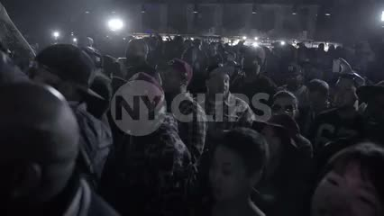 crowd watching hip hop show - fans cheering in slow motion